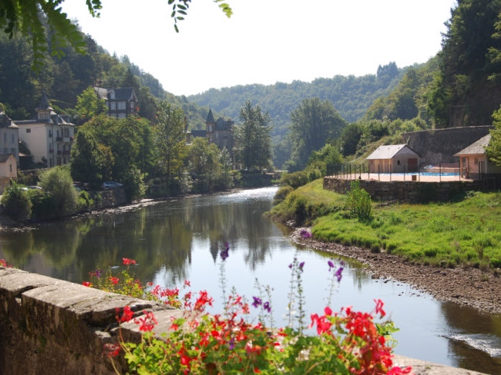View down the river with geraniums